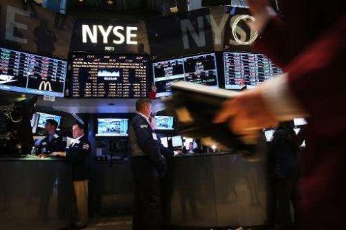 Traders work on the floor of the New York Stock Exchange on June 20, 2014 in New York City