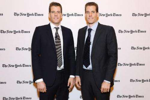 Tyler Winklevoss (L) and Cameron Winklevoss at the New York Times Building on November 12, 2013 in New York City