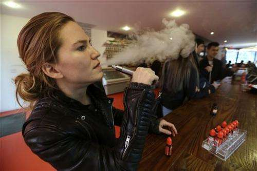 Users bemoan e-cigarette bans in NYC, Chicago