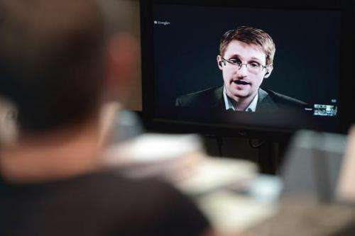 US National Security Agency whistleblower Edward Snowden speaks to European officials via videoconference, at the Council of Eur