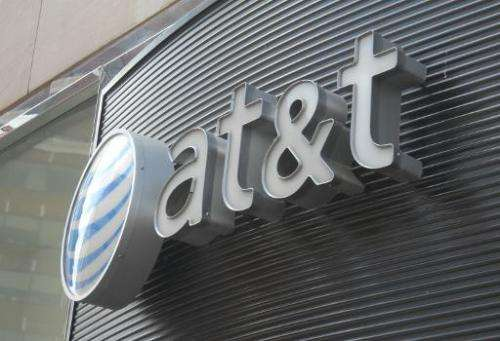 US telecommunications giant AT&T clinched a deal Sunday to acquire broadcast satellite service providerDirecTV for nearly $