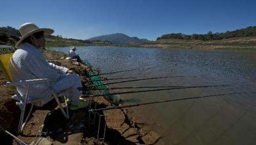 View of fishermen in the Jaguari dam during a drought affecting Sao Paulo state, on August 19, 2014