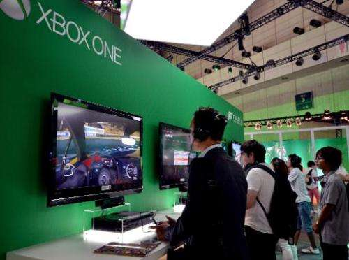 Visitors play US software giant Microsoft's Xbox One at the Tokyo Game Show in Chiba, suburban Tokyo on September 19, 2013