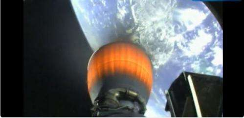 """Watch the Falcon 9 rocket booster descend into the ocean for its """"soft"""" landing"""
