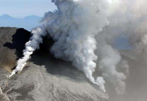 White smokes rises from Mount Ontake on September 28, 2014, one day after it erupted in central Japan