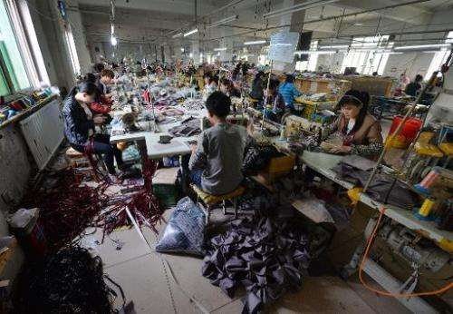 Workers at a handbag factory completing orders to be sold through the Chinese internet e-commerce site Taobao in Baigou, Hebei P