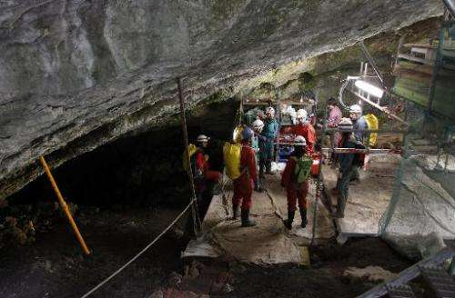 "Workers carrying out an excavation at the Atapuerca archaeological site prepare to go down to the ""Sima de los Huesos"""
