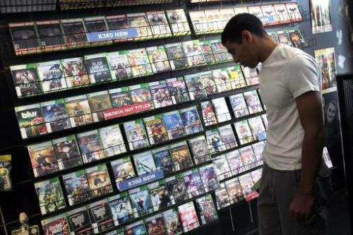 Xabriel Carpio shops for a video game on June 27, 2011 in Miami, Florida