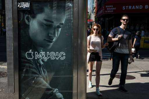 An advertisement for Apple Music is posted on the streets of Manhattan on August 7, 2015 in New York City