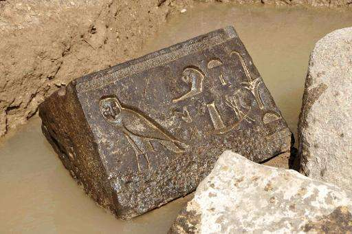 A picture released by Egypt's Supreme Council of Antiquities on April 14, 2015 shows a carved basalt block, a piece that belongs