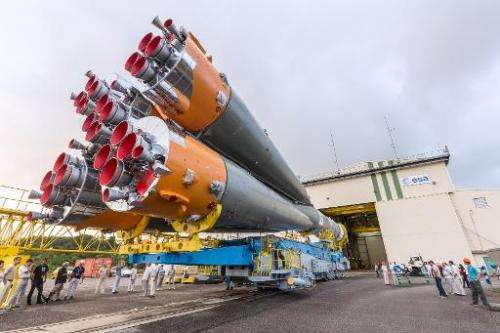 A Soyuz rocket is moved from its assembly building to its launch pad at the Guiana Space Centre in Kourou, French Guiana, on Mar