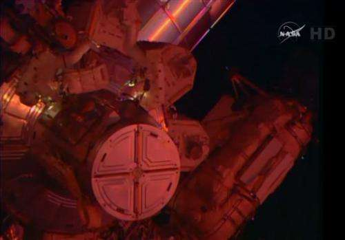 Astronauts take 2nd spacewalk for cable, lube job