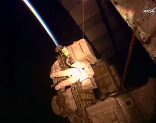 Astronaut takes spacewalk right before setting US record
