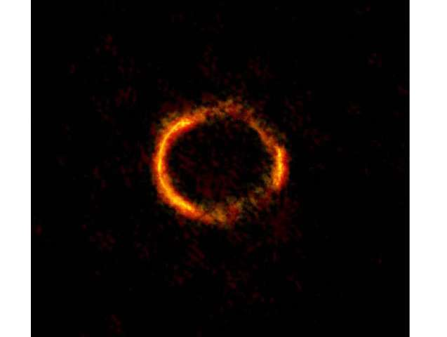 """Astronomers """"weigh"""" a galaxy's black hole by studying the einstein ring phenomenon"""
