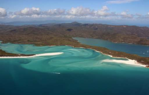 Australia has approved a controversial port expansion to support coal mining projects and the dredging of spoil despite conserva