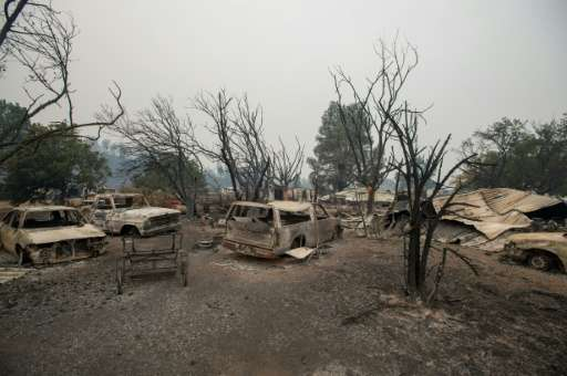 Burned vehicles sit at a property charred by the Valley fire  in Middletown, California on September 13, 2015