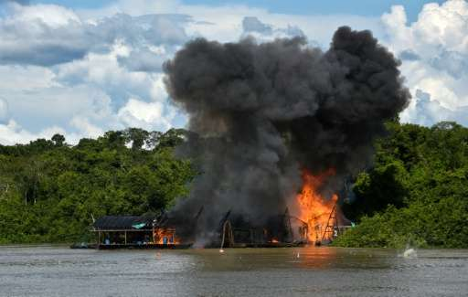 Explosives detonate at an illegal gold mine during the Anostomus II operation against illegal mining in the Puinawai National Na
