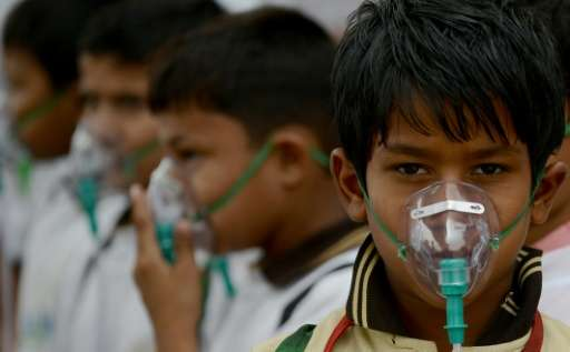 Indian schoolchildren wear facemasks to spread awareness of the problem of air pollution in New Delhi, after the World Health Or
