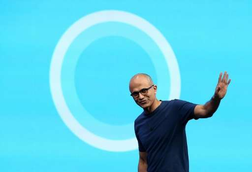Microsoft CEO Satya Nadella walks in front of the new Cortana logo during the 2014 Microsoft Build developer conference on April