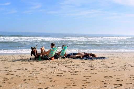 People enjoy the weather at the Assateague Island National Seashore near Berlin, Maryland on November 27, 2015