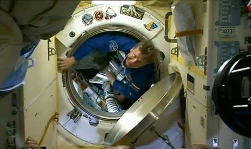 Russian cosmonaut Gennady Padalka, pictured entering the International Space Station in March, has spent a total of 879 days in