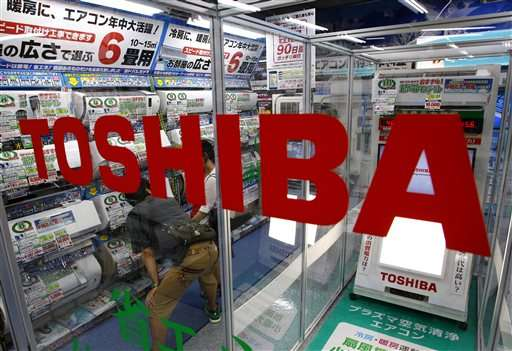 Scandal-hit Toshiba cuts jobs, sells plant, projects red ink