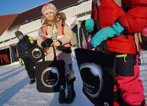 School children show off eclipse bags they bought at the Svalbard Museum on March 19, 2015 ahead of the March 20 total solar ecl