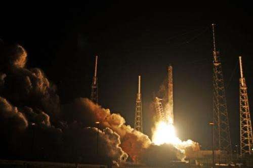 Space X's Falcon 9 rocket launches on January 10, 2015 as it heads to space from pad 40 at Cape Canaveral, Florida, carrying the