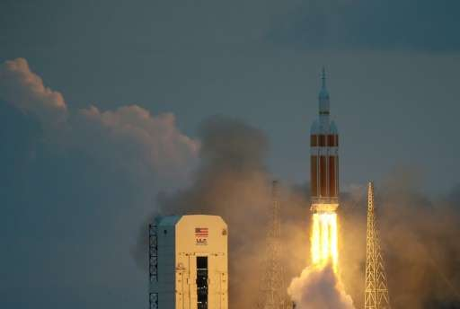 The United Launch Alliance Delta 4 rocket carrying NASA's first Orion deep space exploration craft takes off from the launch pad