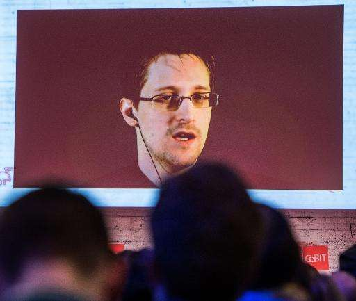 US National Security Agency whistleblower Edward Snowden speaks via live video call during the CeBIT technology fair in Hanover,
