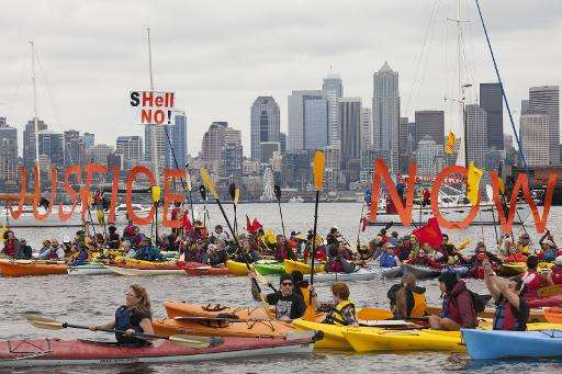 Environmental activists in Seattle paddle out to sea to protest a Shell oil rig moored off the coast of the US city that is head