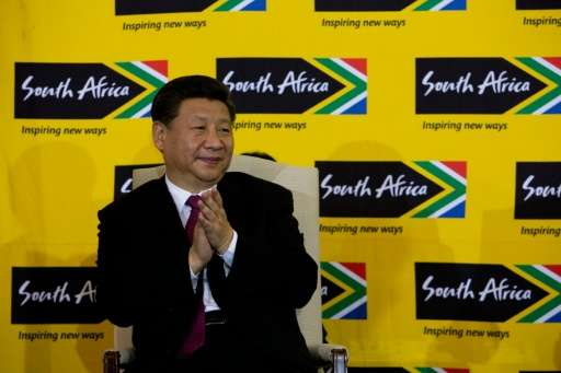 "Chinese President Xi Jinping, pictured in Pretoria on December 2, 2015, pledged ""to take significant and timely steps to ha"