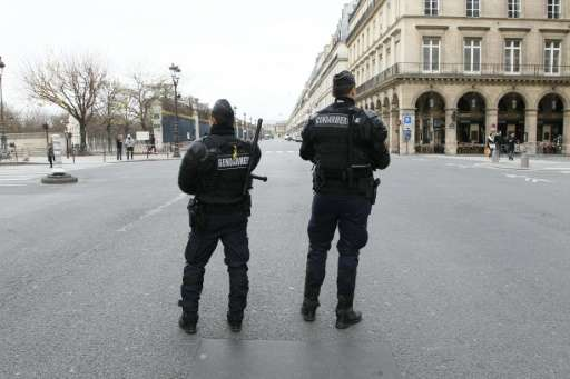 French police stand guard on November 30, 2015 on Rue de Rivoli in Paris, closed to traffic due to the COP21 Climate change conf