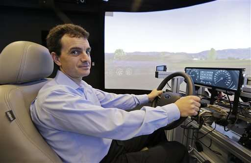 High-tech cars bring Detroit, Silicon Valley face to face