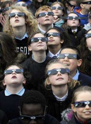 School children gather to view the partial solar eclipse at the Glasgow Science Centre in Glasgow, Scotland on March 20, 2015