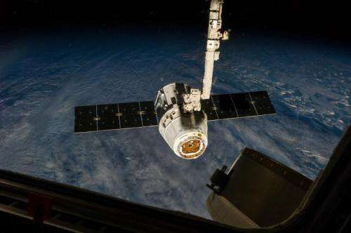 Space station 3-D printed items, seedlings return in the belly of a Dragon