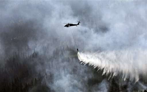 Western wildfires: Firefighters battle blazes in four states