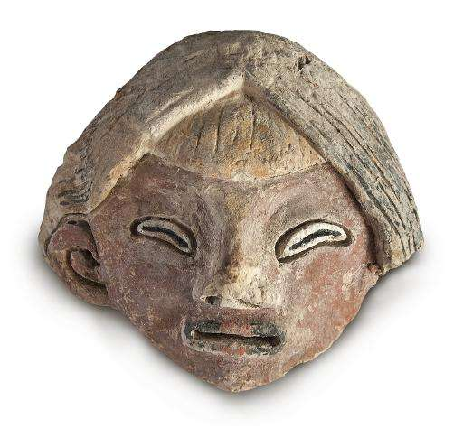 A photo released on June 9, 2015 by the Peruvian Ministry of Culture shows a mud figurine of a face in Lima