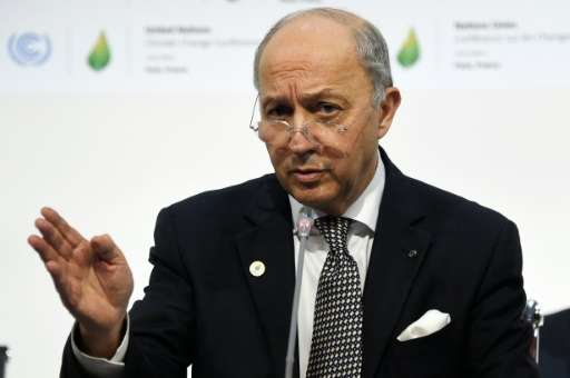 French Foreign Minister Laurent Fabius takes part in a plenary session at the COP21 United Nations climate change conference in