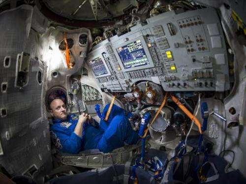 NASA astronaut Scott Kelly inside a Soyuz simulator at the Gagarin Cosmonaut Training Center in Star City, Russia on March 4, 21