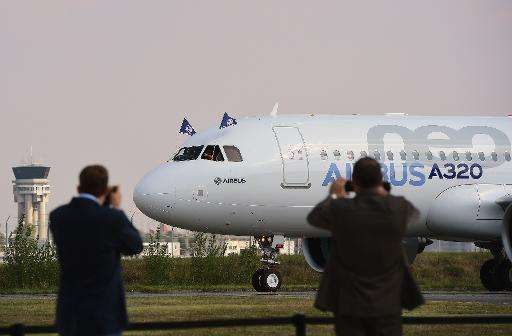 People take pictures of the Airbus A320neo on September 25, 2014 at Blagnac airport near Toulouse, after its first test flight