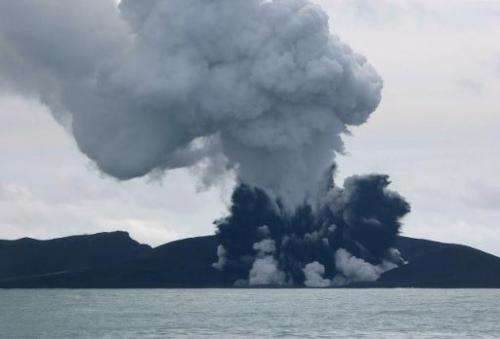 Smoke rises from a volcano some 65 km south-west of the South Pacific nation Tonga's capital Nuku'alofa, as seen in this image f