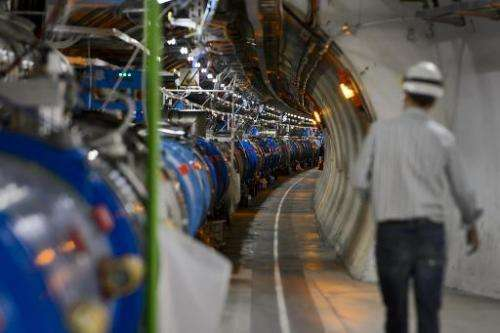 The Large Hadron Collider comprises a ring-shaped tunnel straddling the Franco-Swiss border, in which two beams of protons are s
