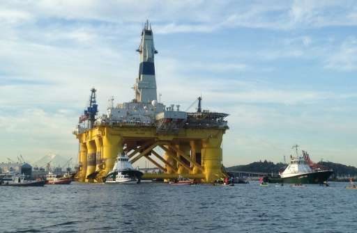 "Greenpeace activists in kayaks try to block the departure of the Shell Oil ""Polar Pioneer"" rig platform as it moved fr"