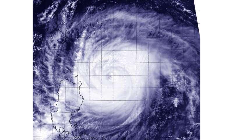 NASA-NOAA's Suomi NPP Satellite sees Typhoon Goni brush northeastern Philippines