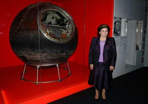 Soviet cosmonaut Valentina Tereshkova poses with the Vostok 6 capsule in London, on September 17, 2015