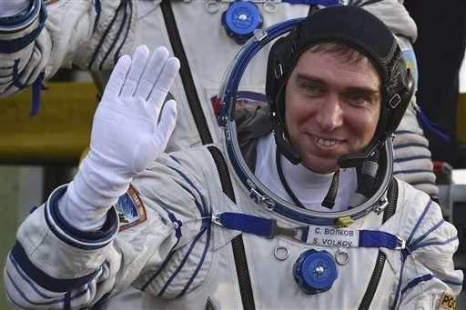 Soyuz carrying 3-man crew blasts off for orbiting station