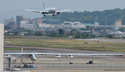 The Solar Impulse 2 solar-powered airplane sits on the apron at Nagoya airport on June 2, 2015