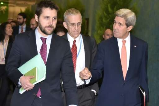 US Secretary of State John Kerry (R) walks with White House senior advisor Brian Deese (L) and US Special Envoy for Climate Chan