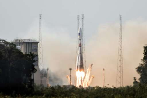 A Soyuz rocket carrying a pair of Galileo In-Orbit Validation satellites lifts off from Europe's Spaceport in Sinnamary, 12km fr